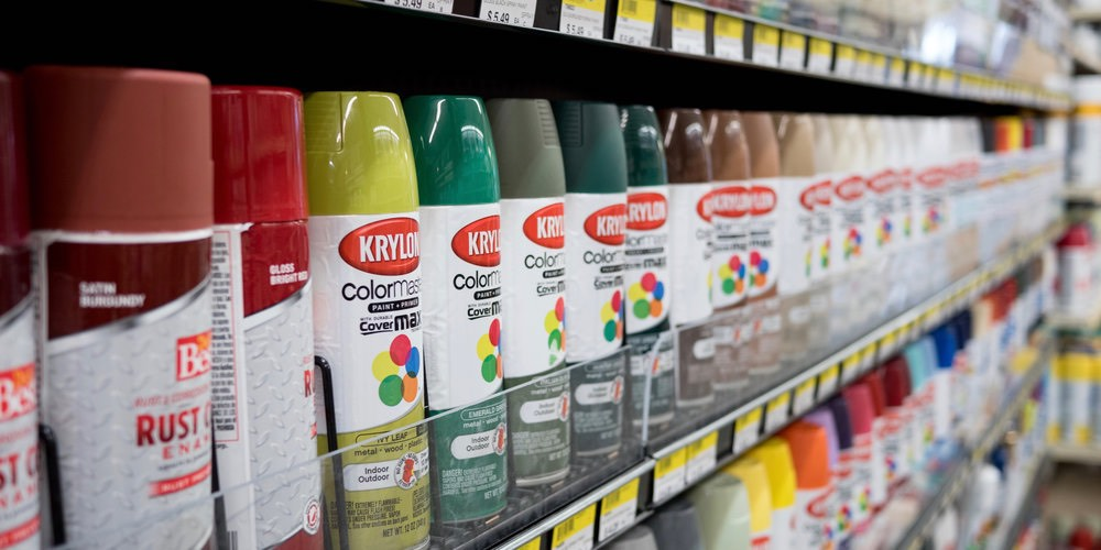 shelf of spray paints